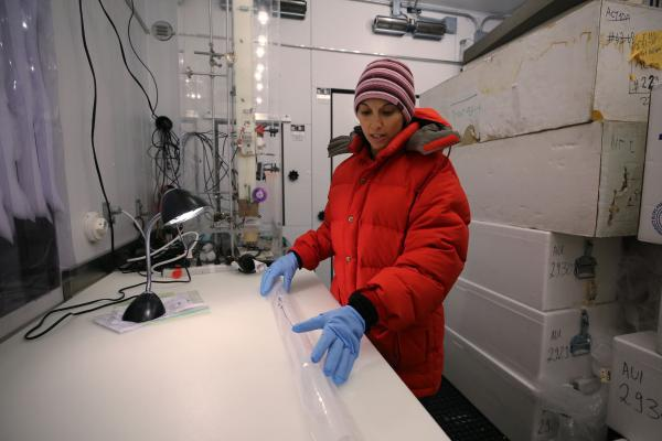 Dr. Monica Arienzo inspects an ice core sample in the ice core lab at the Desert Research Institute in Reno, Nev.